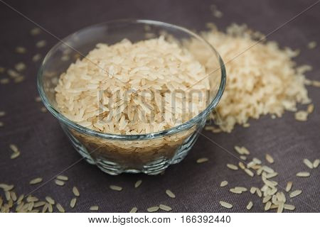 a bowl of rice on grain surface. gluten free product.