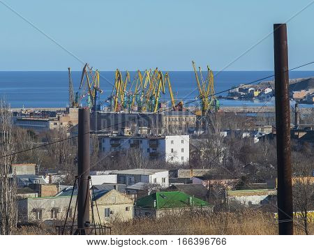 View of the port and the construction cranes at the seaside