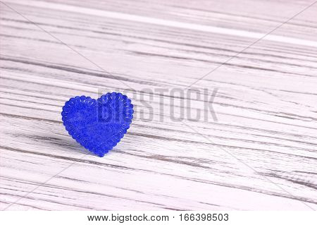 Blue heart of felt on a wooden background. Valentine Day.Greeting card.Wedding