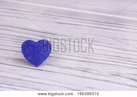 Blue heart of felt on a white wooden background. Valentine Day.Greeting card.Wedding