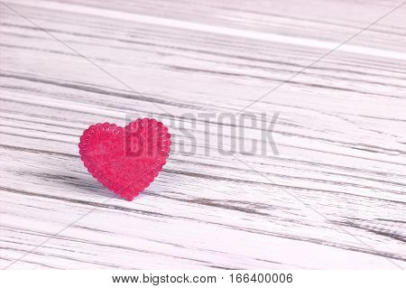 Pink heart of felt on a gray wooden background. Valentine Day.Greeting card.Wedding
