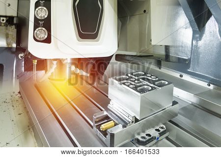The hi-precision vertical CNC machining center with the sample work piece and the lighting effect
