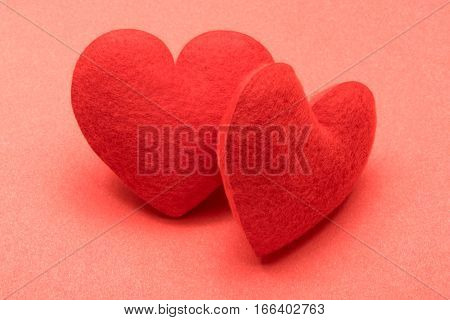 Pair of valentine hearts on red background