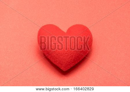 Valentine red heart isolated on red background
