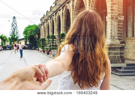 Woman Discovering An Ancient Temple Holding Boyfriend's Hand.