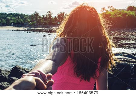 Woman Discovering Tropical Sea Holding Boyfriend's Hand.