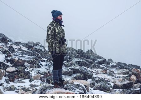 Girl In The Stones With A Camera, Looking At Nature