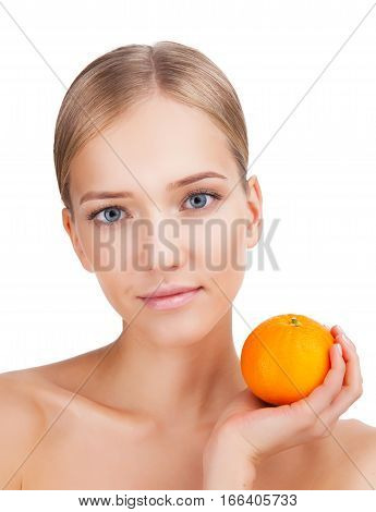 Beauty Woman face Portrait with orange in her hand. Beautiful Blonde Spa model Girl with Perfect Fresh Clean Skin. Skin Care Concept Isolated on a white background
