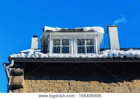 Building With Dormer Windows And Icicles