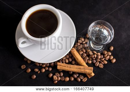 Coffee, Beans And Cinnamon On Dark Background