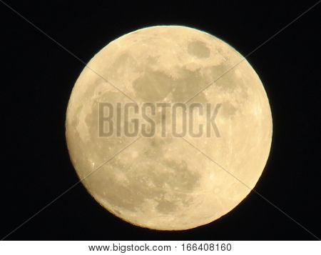 Spectacular full moon, big and lovely. Illuminating the black sky