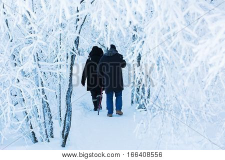Couple Walking In A Snowy Landscape