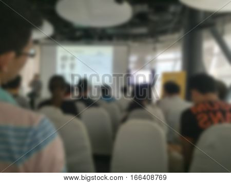 Abstract blurred . people lecture in seminar room .