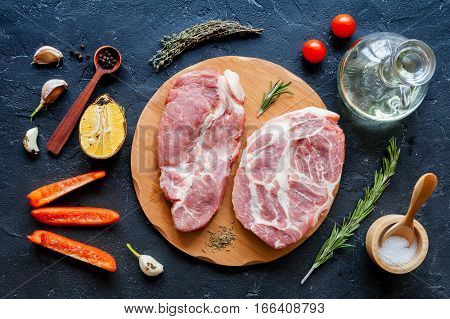 concept cooking meat steak on dark background top view.