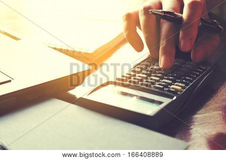 Closeup Woman Hand Using Calculator And Calculate About Cost At Home Office.