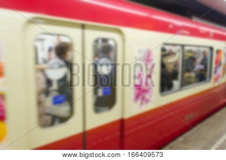 Abstract blur .Commuters are packed inside a train .
