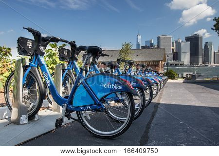 New York, August 19, 2016: A Citibike station on Governor's Island with downtown Manhattan seen in the background.