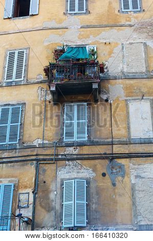 Facade Of An Old House In Siena