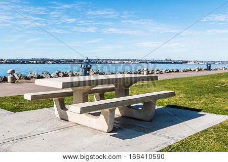 Picnic table at Embarcadero Marina Park North, with San Diego bay in the background.