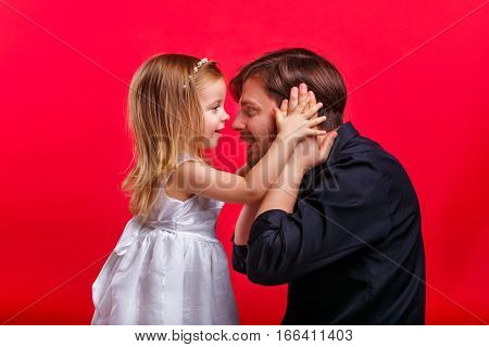 Father and daughter playing. The girl closed her hands over her ears to his father. He covered his ears. Emotional games with your child. Family fun. The joy of communication. Can not hear anything.
