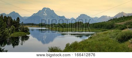 Grand Tetons Mountain Range reflecting in the Snake River in Grand Tetons National Park