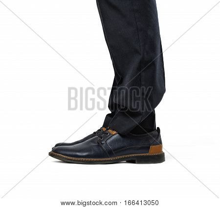 Two man's feet in fashionable black and brown shoes and black trousers isolated on the white background. Fashionable shoes. Stylish footwear. Official clothing