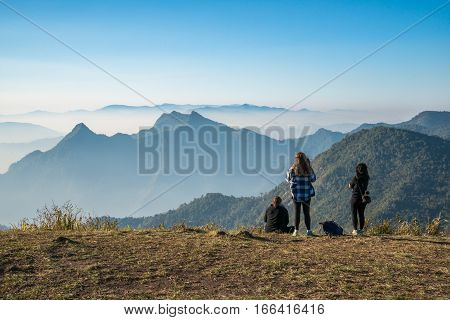 The traveller women standing to see the highland mountains in northern region of Thailand.