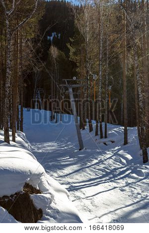 Ski Lift In The Mountains Through The Woods