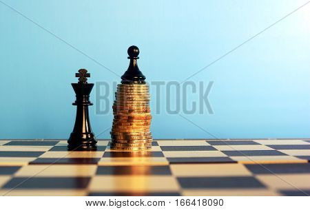 Chess Pieces On Stacked Coins