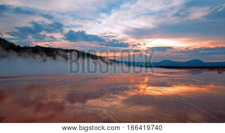 Grand Prismatic Spring at sunset in the Midway Geyser Basin in Yellowstone National Park in Wyoming United States