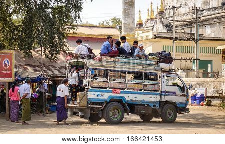 People With The Local Bus On Rural Road In Myanmar
