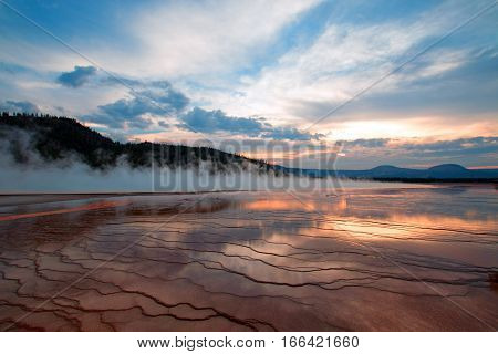 Grand Prismatic Spring At Sunset In The Midway Geyser Basin In Yellowstone National Park In Wyoming