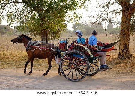 Horse Cart Carrying Tourists On Dusty Road