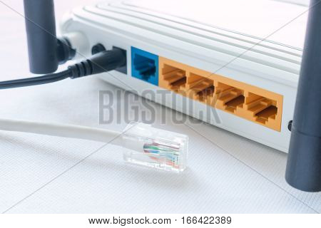 Internet Cable And A Router On A White Background