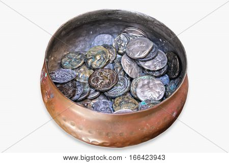 Old coins in a pot. Placer ancient coins. Treasure.