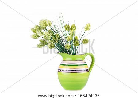 Green plastic plants in vase isolated on white background.