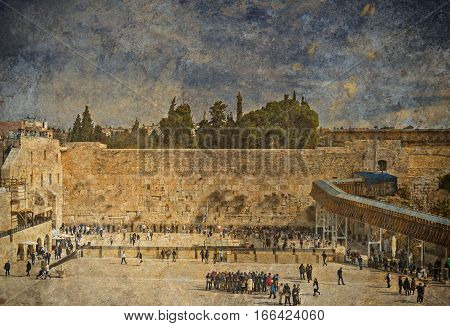Ancient Western Wall in Jerusalem is a major Jewish sacred place and one of the most famous public domain in the world, Jerusalem, Israel. Textured and toned image for inspiration of retro style