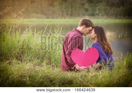 Loving Couple. Beautiful Young Love Couple Holding Paper Hearts And Smiling In Outdoor Nature Vintag