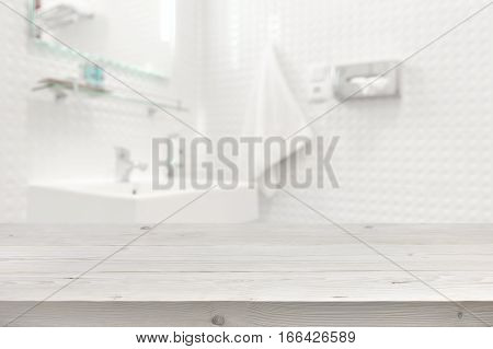Wooden planks surface and blurred bathroom interior as background