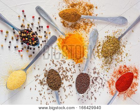 Top view mix indian spices and herbs difference on white background. Food background for design vegetable, healthy lifestyle, spices, herbs or foods content