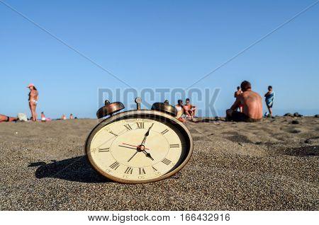 Clock On The Sand Beach