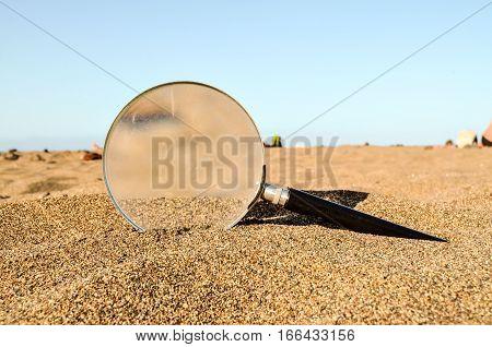 Magnify Glass On The Sand Beach