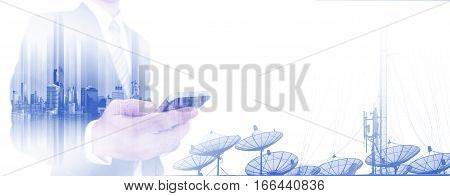 Double exposure businessman using smart phone with satellite dishes on white backgrounds, with copy space