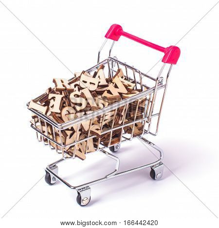 Shopping basket with letters of the alphabet made of wood on a white isolated background