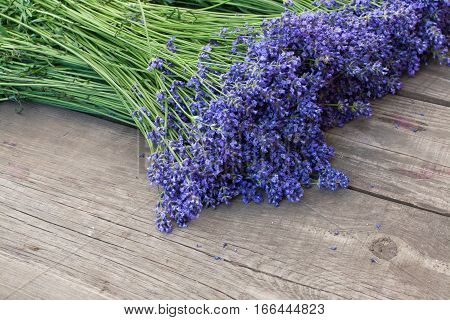 Bouquets of lavender on vintage wood background