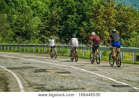 Cyclists on mountain road in Caucasus, Russia