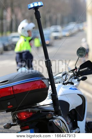Motorcycle Police With Flashing Siren And A Traffic Officer On T