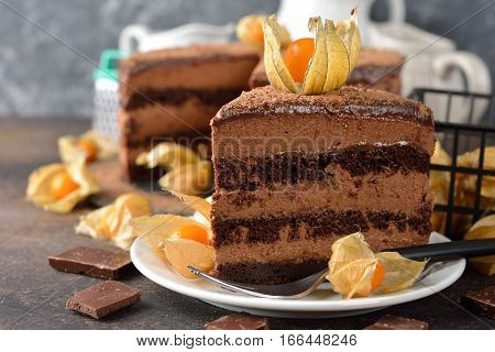 Cake with chocolate mousse on a brown background