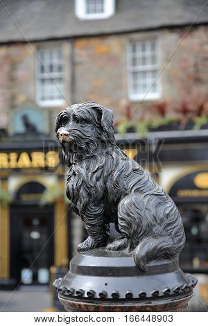 EDINBURGH, SCOTLAND - MAY 6, 2016:Statue of Greyfriars Bobby with a pub in the background