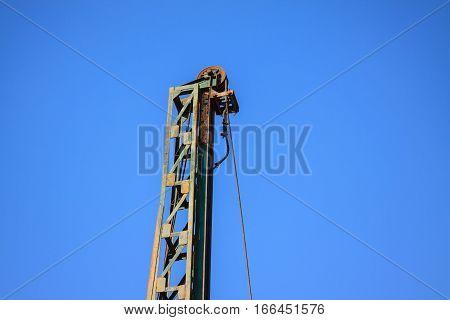 Lack of crane hook construction crane and blue sky. Constructiona and building equipment